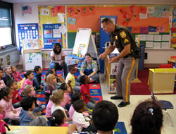 Police officer speaking to a group of Head Start students